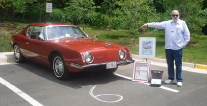 John Fantucchio with his red 1963 Studebaker Avanti on June 5th 2010.